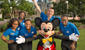 Disney Dreamers pose with Mickey Mouse in front of Cinderella Castle at Walt Disney World Resort