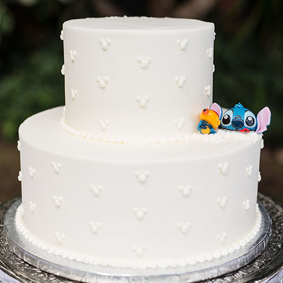 White wedding cake with Stitch popping out of it