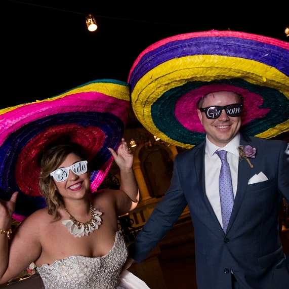 Bride and groom wearing sombreros at Epcot's Mexico Pavilion.