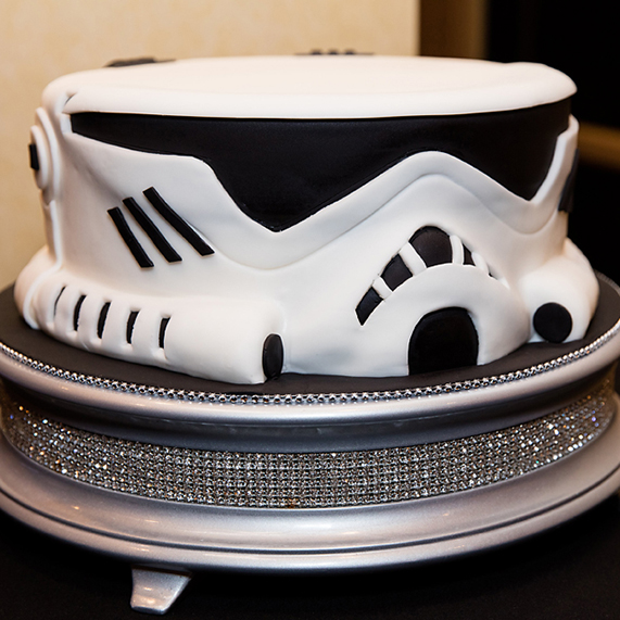 Star Wars inspired wedding cake of Stormtropper helmet.