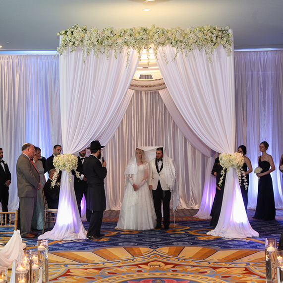 Wedding ceremony with chuppah at Disney's Yacht & Beach Club Resort Ballroom