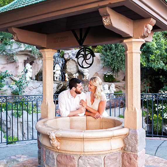 Taylor and Thomas holding hands by the wishing well