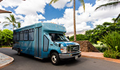 An Aulani shuttle bus parked on a driveway
