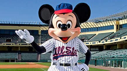 Mickey Mouse dressed in a baseball uniform, standing on a baseball field