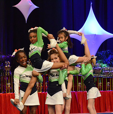 Young cheerleaders perform maneuvers