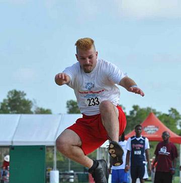 A man practices a long jump