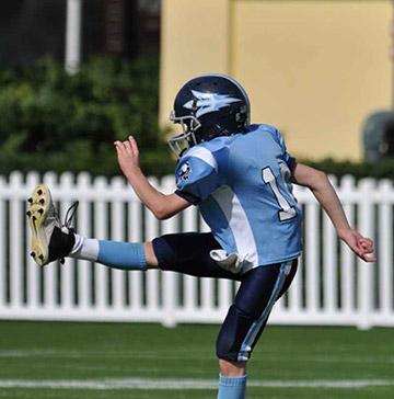 A football player follows through on a kick