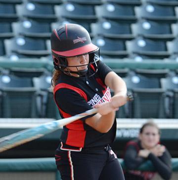 A softball batter swings her bat
