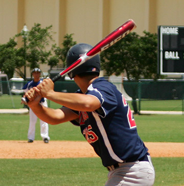 baseball player swings a bat