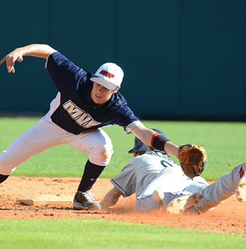 A runner slides safely into second base before a shortstop can make a play