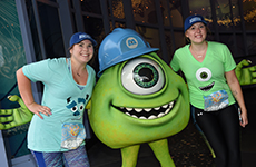 Runners pose with Mike Wazowski during Disneyland Half Marathon Weekend at Disneyland Resort.