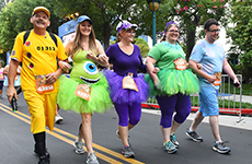 "Runners dressed as characters from ""Monsters, Inc."" approach the finish line during Disneyland Half Marathon Weekend."