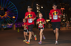 "Runners dressed as ""The Incredibles"" run through Disney California Adventure Park during Disneyland Half Marathon Weekend."
