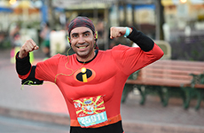 Male runner dressed as Mr. Incredible runs through Disneyland Resort during Disneyland Half Marathon Weekend.