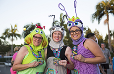 "Runners dressed as characters from ""A Bug's Life"" pose with their finisher medals during Disneyland Half Marathon Weekend at Disneyland Resort"