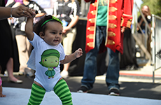 "Baby runner dressed as Disgust from ""Inside Out"" participates in the Diaper Dash at the runDisney Kids Races during Disneyland Half Marathon Weekend at Disneyland Resort."