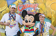 Runners celebrate with Mickey Mouse after the Castaway Cay 5K for the Castaway Cay Challenge during Walt Disney World Marathon Weekend.