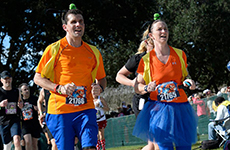 Runners dressed as Goofy run the Walt Disney World Marathon.