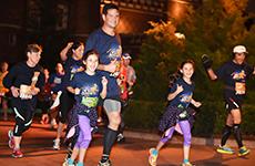 Family runs through Epcot for the Walt Disney World 5K.