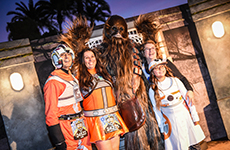 Family of runners pose with Chewbacca during Star Wars 10K at Disneyland Resort.