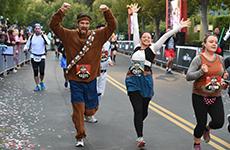 Runners cross the finish line of the Star Wars 10K at Disneyland Resort.