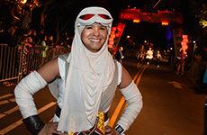 Runner dressed as Rey at the finish line of the Star Wars 5K at Disneyland Resort.
