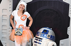 Runner dressed as BB-8 poses with R2-D2 during Star Wars Half Marathon – The Light Side at Disneyland Resort.