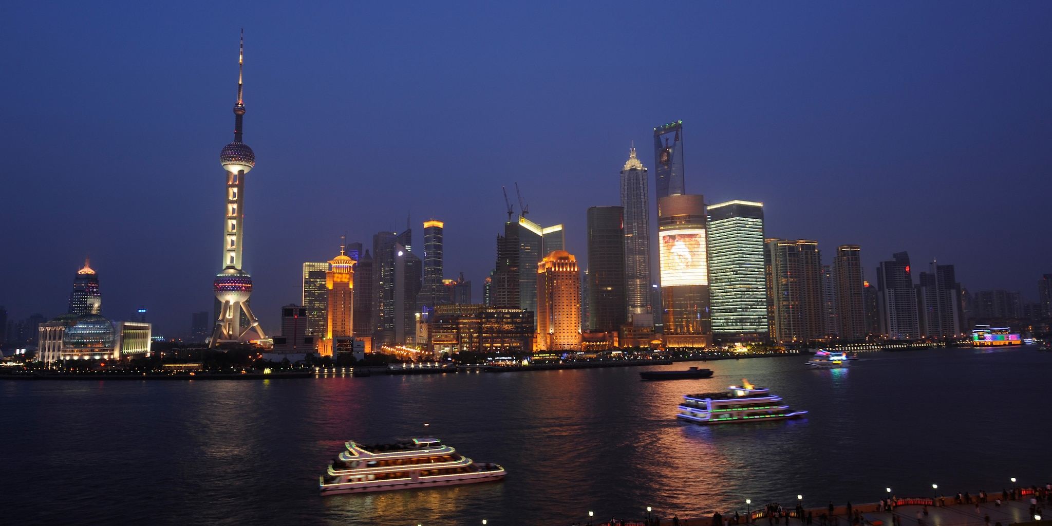 The Shanghai skyline across the harbor at night