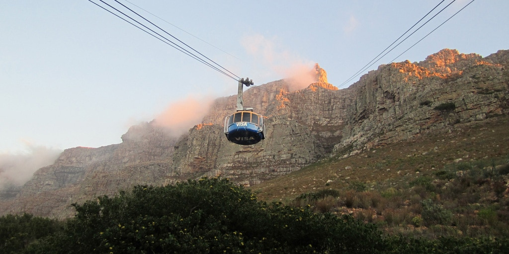An aerial cableway car climbs to the top of Table Mountain