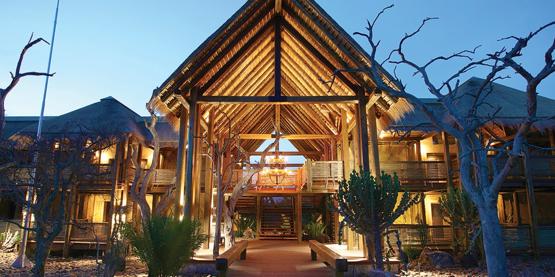 The main entrance of the Kapama River Lodge is illuminated as night falls