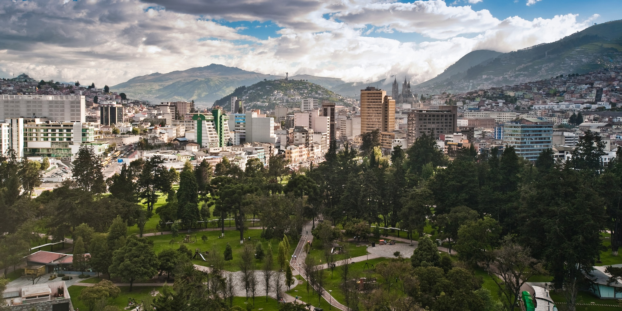 A park surrounded by the city and mountains of Quito, Ecuador