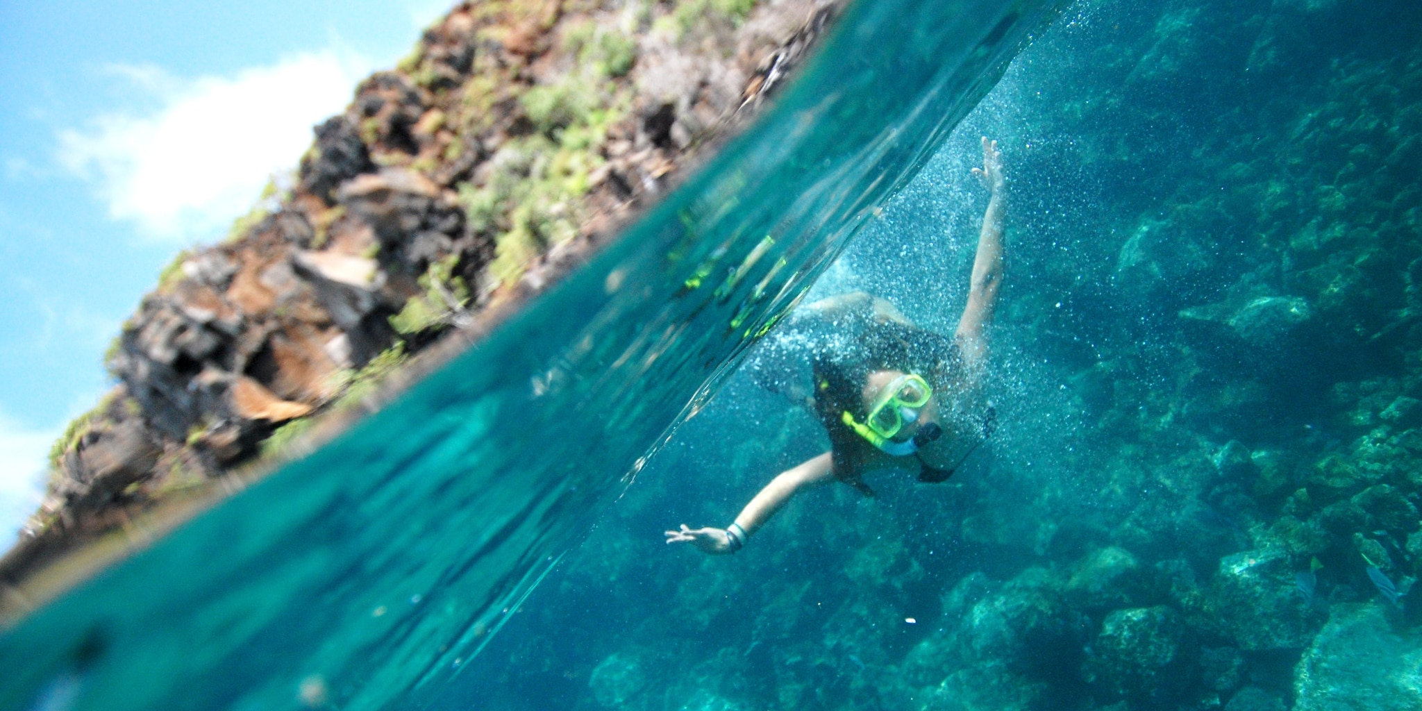 A girl is snorkeling under water