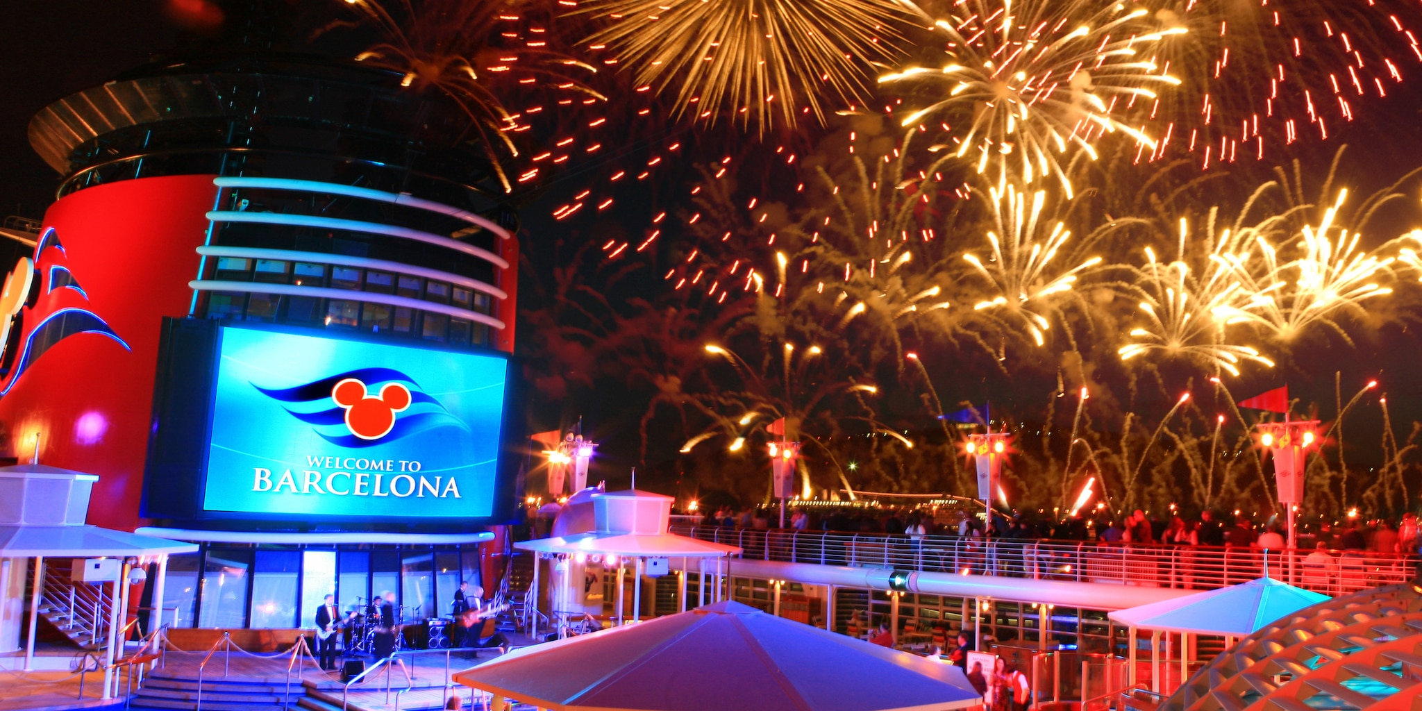 Fireworks light up the sky over the Disney Magic
