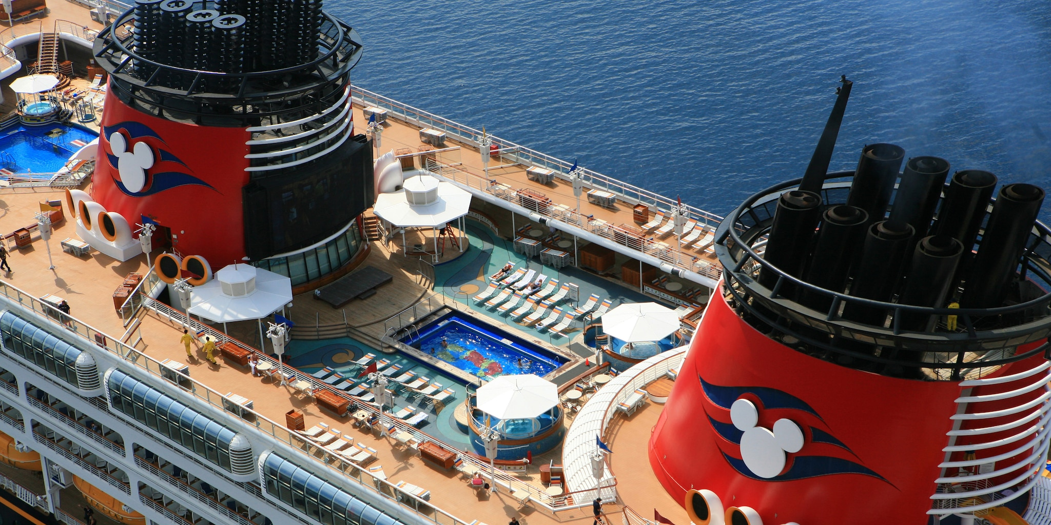 The pool and upper deck of the Disney Magic® Cruise Ship