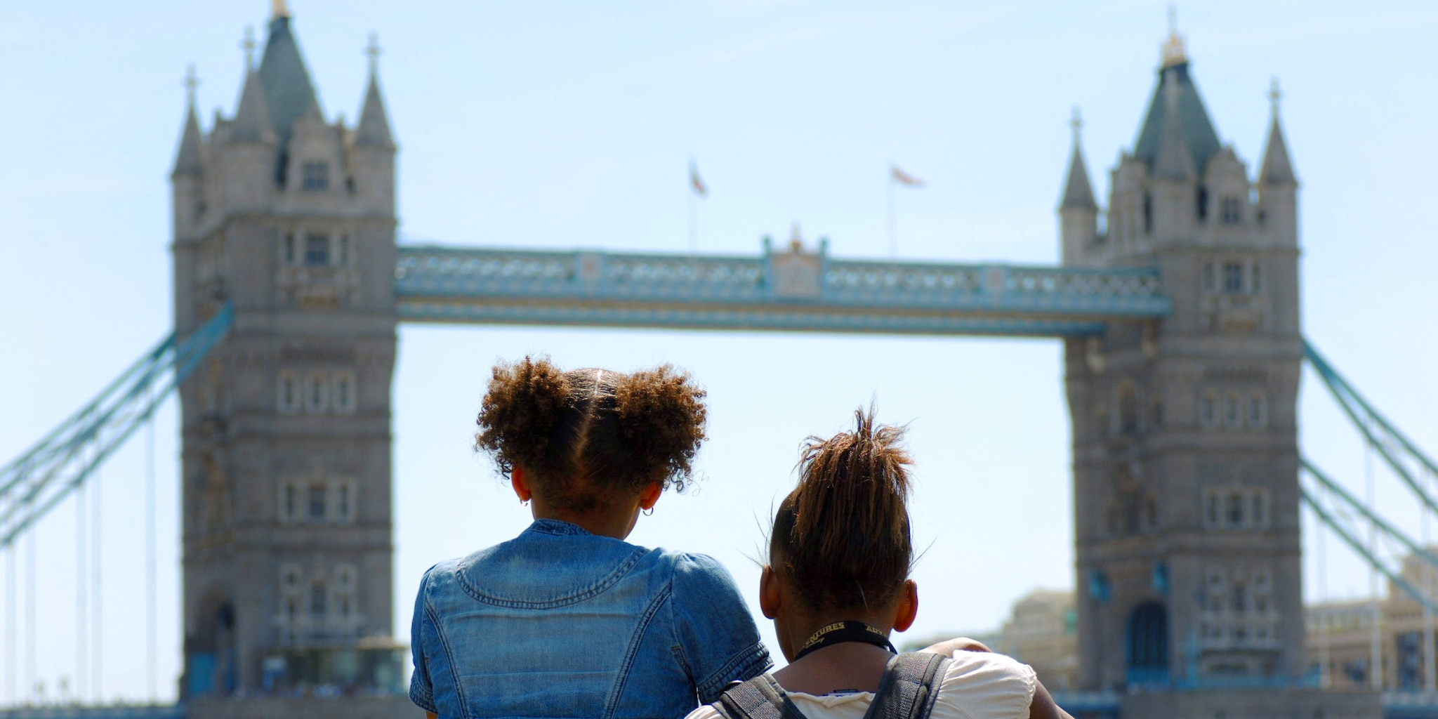 Two girls look at London Bridge