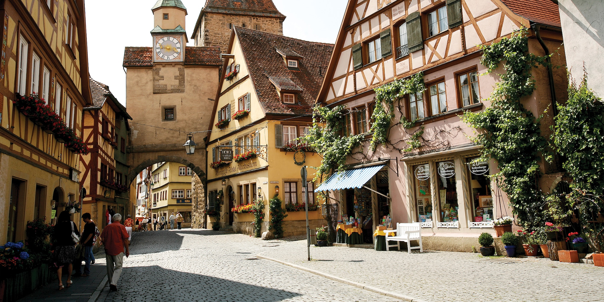 Shops line a cobblestone street in the storybook style town of Rothenburg