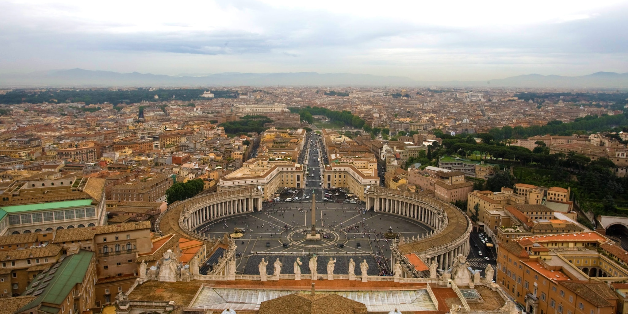 Vatican City surrounded by the city of Rome and distant mountains