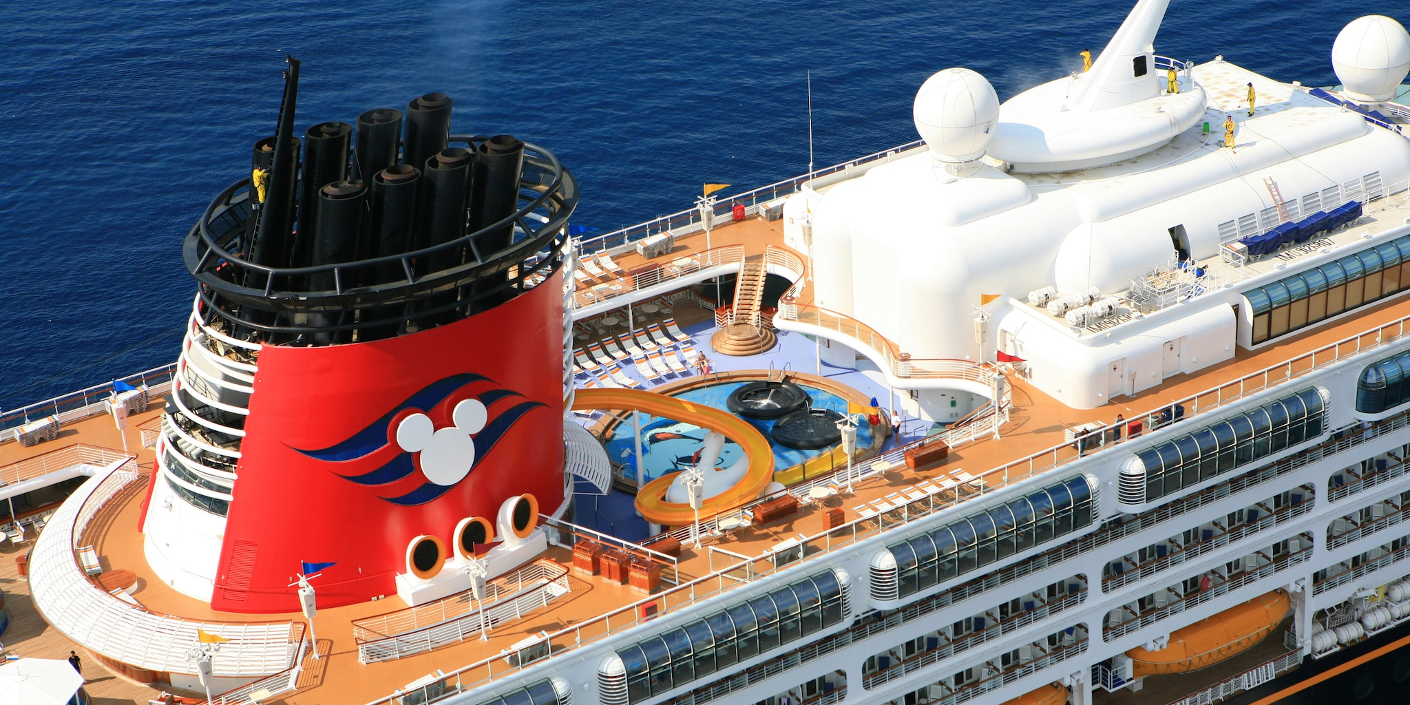 The pool and upper decks of the Disney Magic®