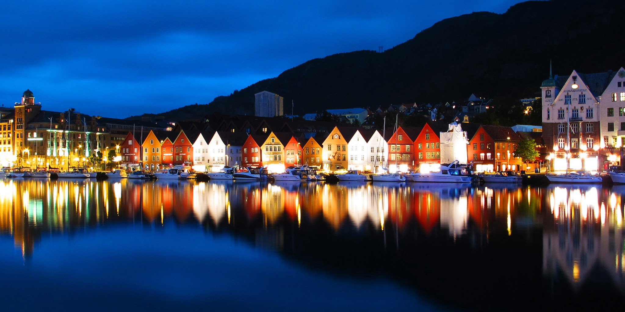 Lighted buildings alongside the water