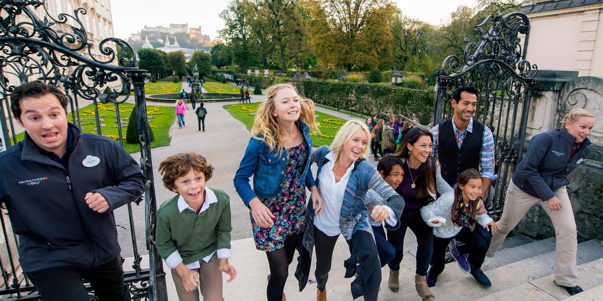 A family and an Adventure Guide run through iron gates