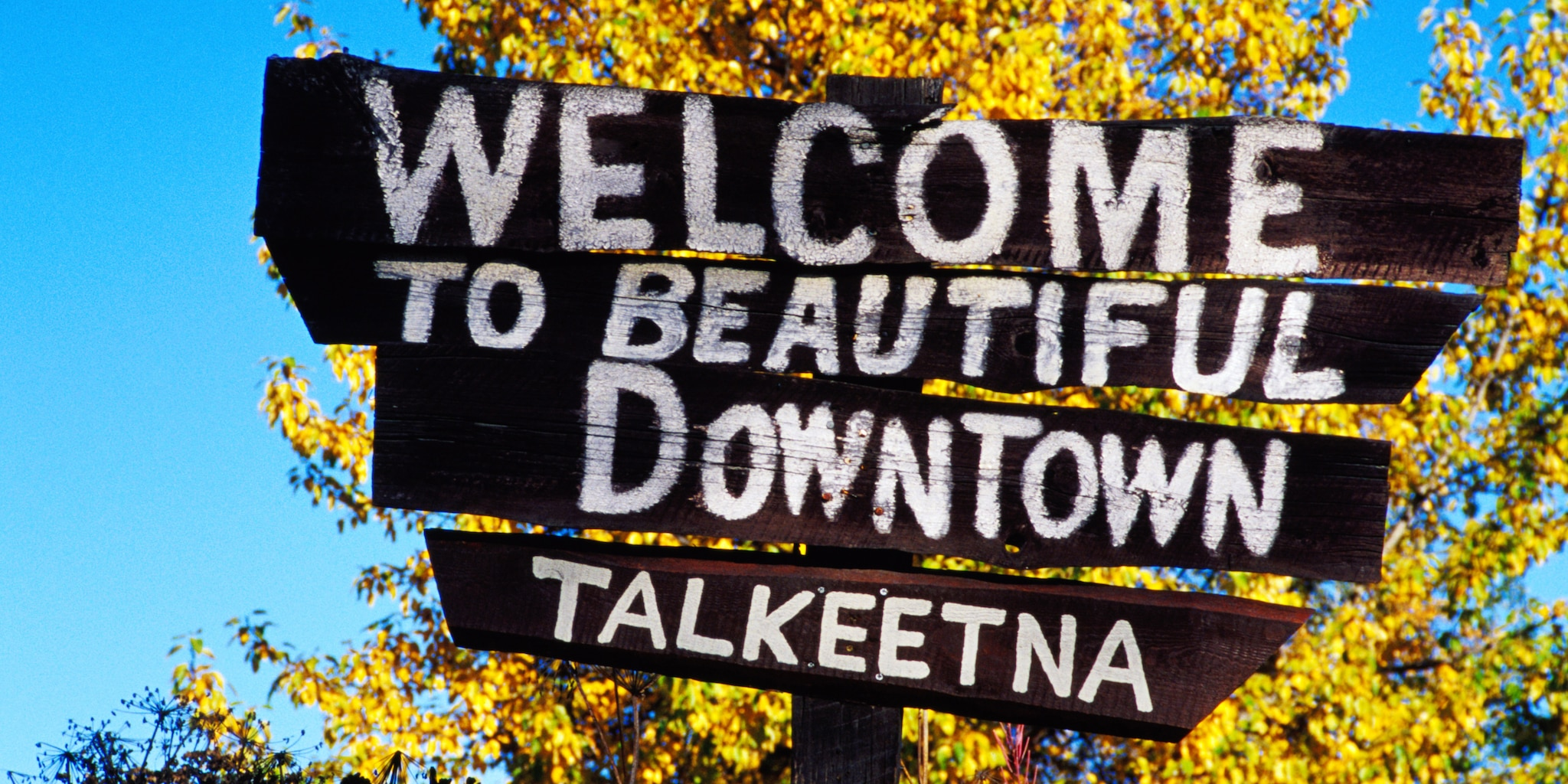 "Sign reads ""Welcome to beautiful downtown Talkeetna"""