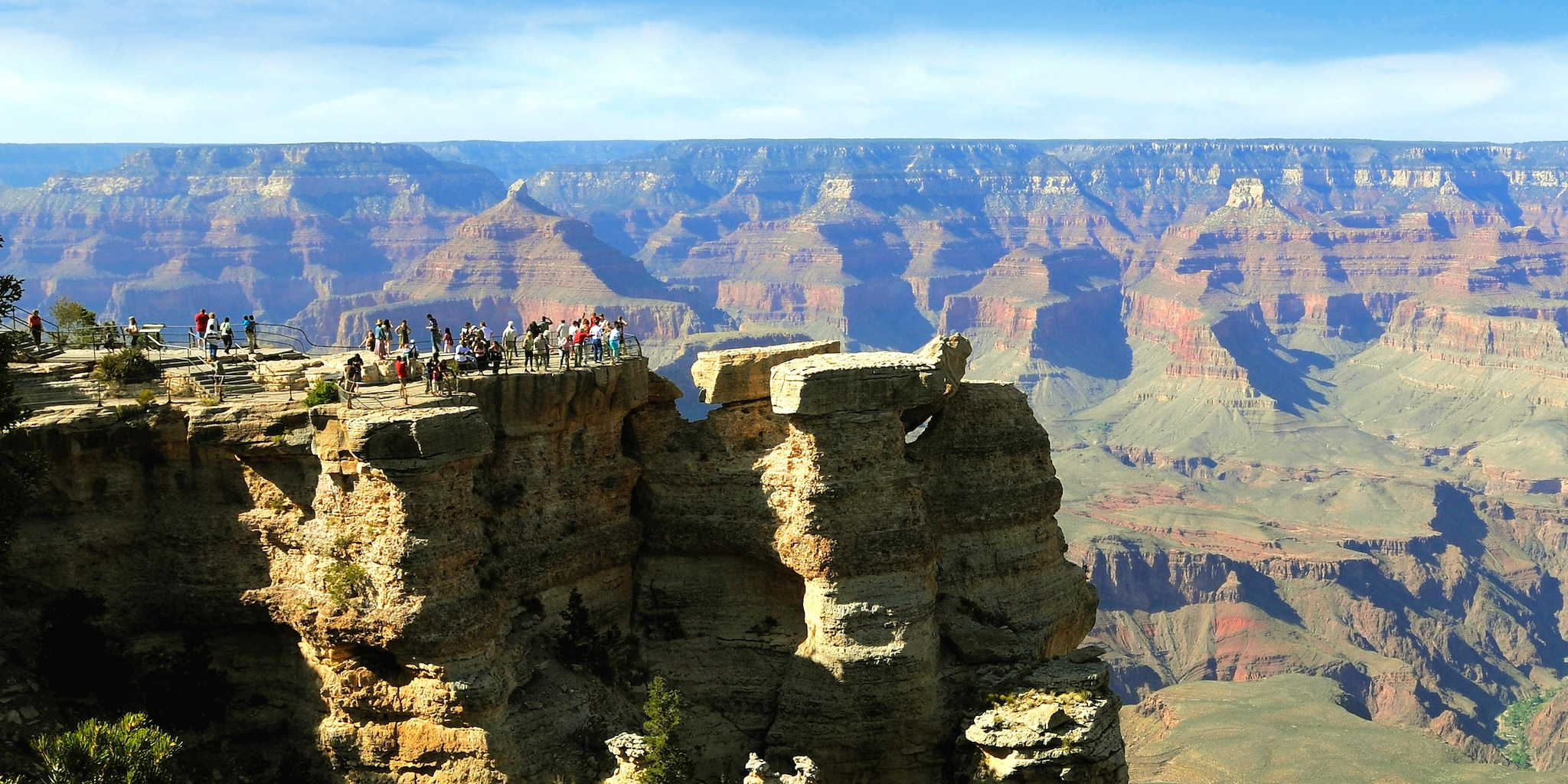 Tourists take in the views high above the walls of the Grand Canyon's South Rim