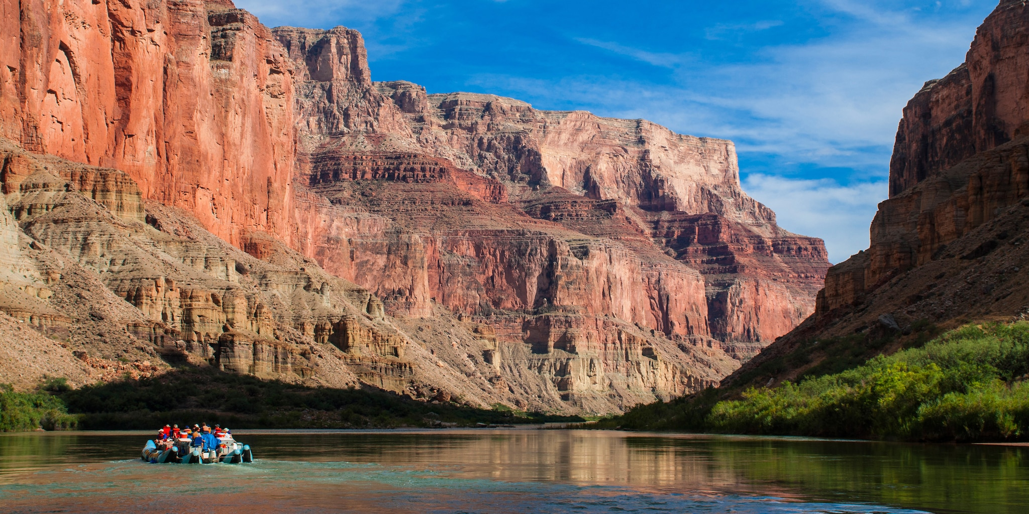 A group of tourists raft down one of the Colorado River's more tranquil spots