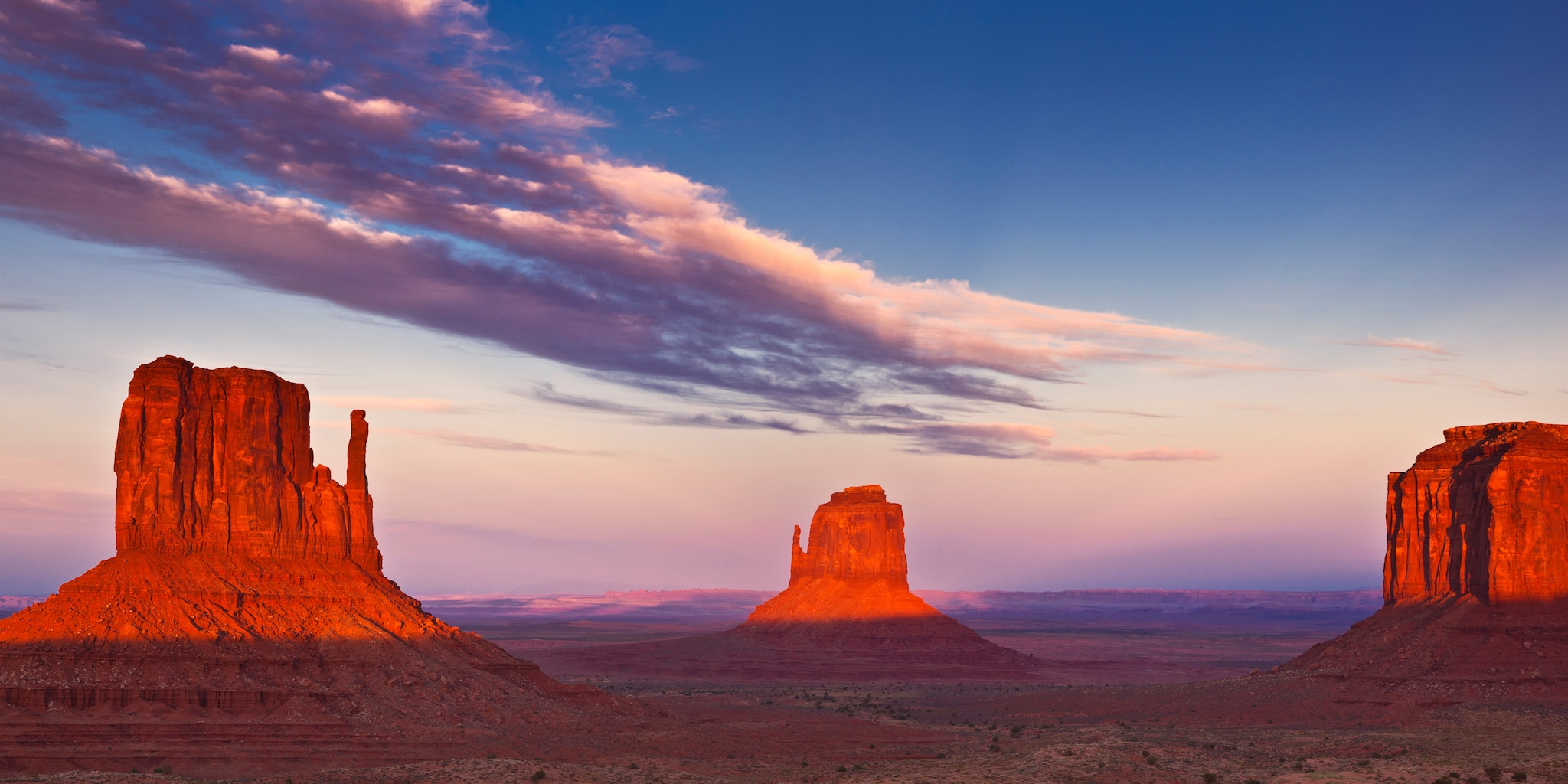 Sunset over Monument Valley's panorama of sandstone buttes