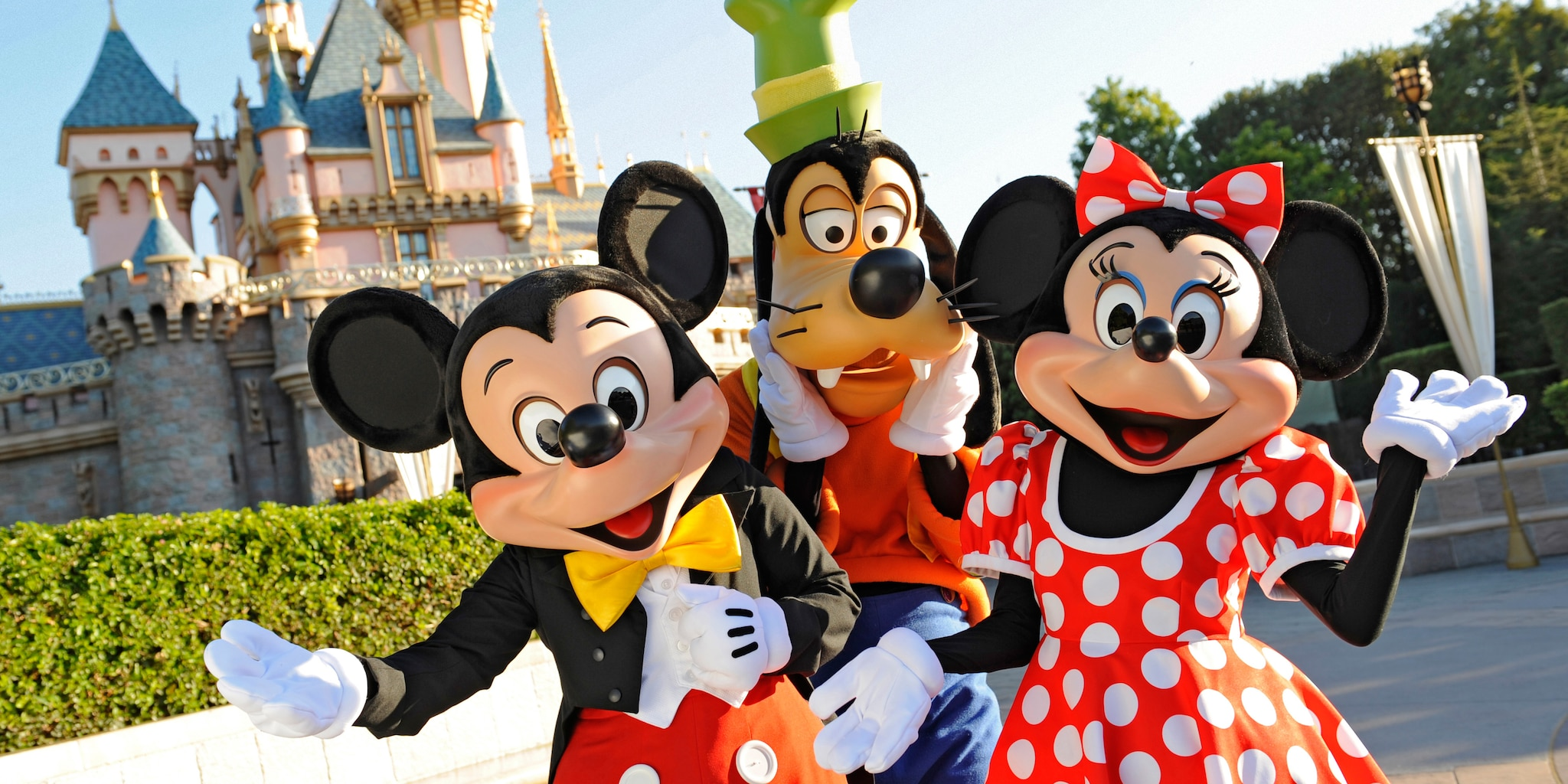 Mickey Mouse, Minnie Mouse and Goofy Characters outside Sleeping Beauty Castle at Disneyland Park
