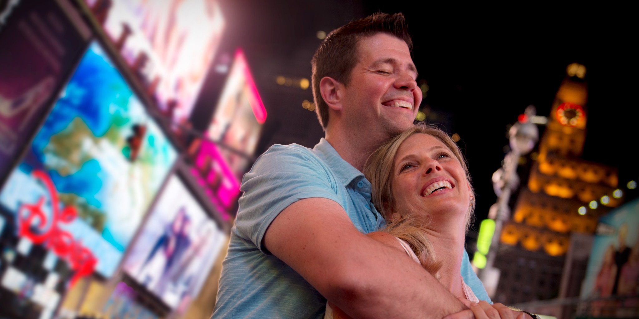Couple enjoying Times Square at night