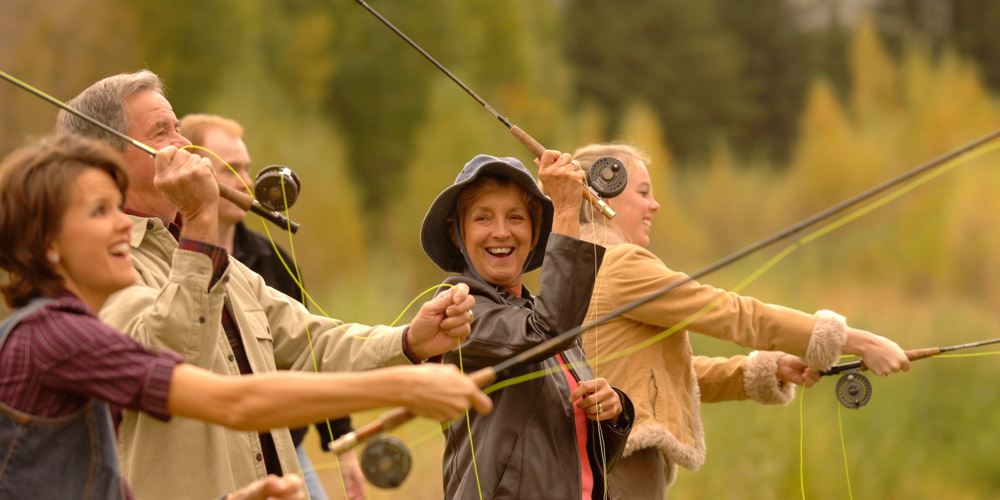 Several people casting fishing rods