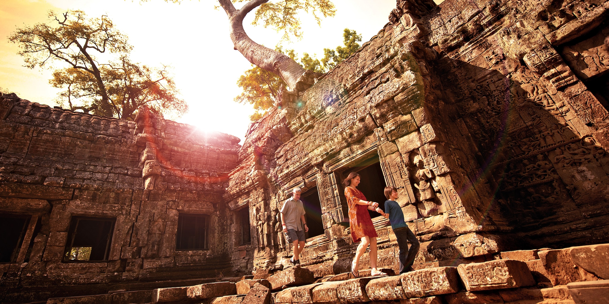 A mom, dad and son explore Angkor Archaeological Park