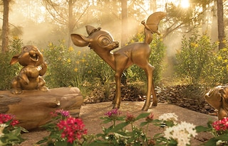 A wooded outdoor area with statues of Bambi and Thumper from the film 'Bambi'