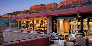 An outdoor hotel patio at dusk